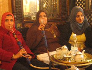 Women smoking Shisha in a back room of a cafe in Cairo